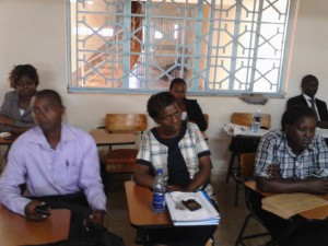 The Post-graduate student following keenly on their fellow presenting and taking heed of the supervisors' remarks.