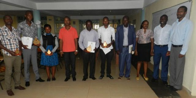 The outgoing JKUSO, incoming JKUSO and staff together posing for the cameraman.