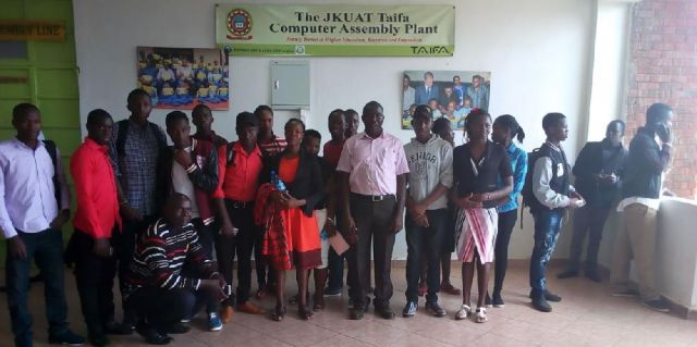 Mr. Hezron Orina, Mr. Denish Matunga together with students partake of a photo at JKUAT Taifa Computer Assembly Plant where they'd visited as an Academic trip.
