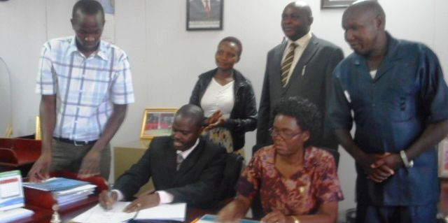 The Signing of an MOU between Kisii CBD campus and Kisii County, Health Services. Behind and on looking are Prof. J.K Sigei (Director, Kisii CBD), Dr. Walter Okibo (now former Deputy Director), Elizabeth Mong'are (HoD, Health Sciences).