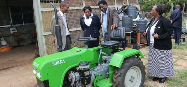 The V.C. Prof. Victoria Ngumi looks on as Prof. Christopher Kanali and the Chief Technologist ABED, Mr. L.O. Mulamu describe the operation of the Shujaa tractor to former Othaya Mp. Honorable Mary Wambui