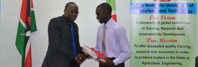 Kipkalya (left) hands over office records to Mr. Jomo at a JKUSO handing over function