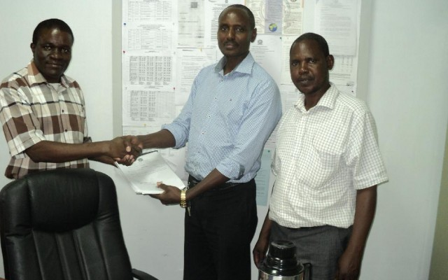 Outgoing Chairman Dr.Thomas Ngigi (Middle) handing over Office to the incoming chair Dr.Patroba Odera.Looking on is Mr Mulefu Oduori(Chief Technologist)