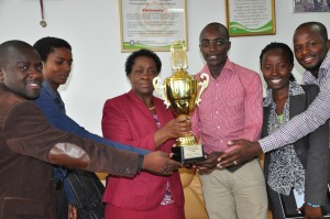 The-Vice-Chancellor-shows-off-the-Trophy-moments-after-receiving-it-from-the-Intel-Ambassadors.