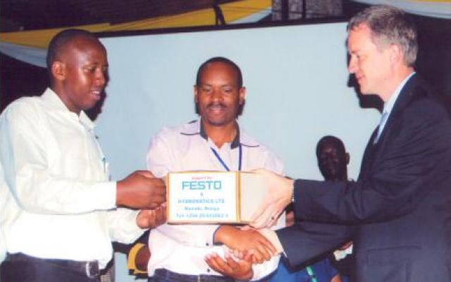 Mr Boniface Kariuki(Centre) and Patrick Kiprono(left) receive the Judges Award for Best Designed Robot at 2013 ROBOKEN Contest
