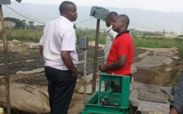 Mr. Karanja Kabini(in red) and Mr. Mumu (far right) on a visit to Bioplast, an SME in Maai Mahiu