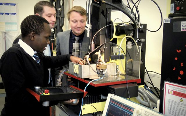 Mr James Wamai (Left), a member of staff in the Department of Mechatronic Engineering presents his research to Dr- Ing Henning Zeidler (Right) and Michael Penzel at Technische Universität Chemnitz, Germany