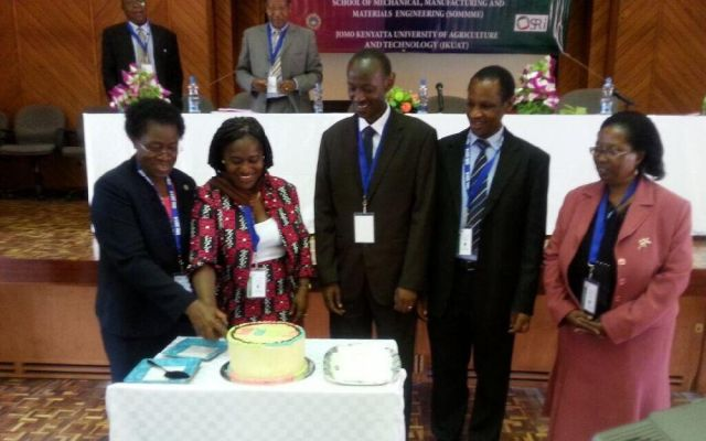 From right: JKUAT Vice Chancellor Prof M Imbuga, Chief guest Dr Peggy cut cake to launch JSRE as Prof (Eng) Ikua ( Principal CoETEC), Prof Nyakoe (Dean SoMMME) and Prof V Ngumi (DVC APD) onlook