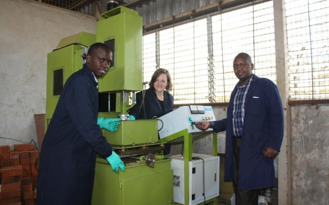 Mr. Samuel Kabini (right), Ms. Sile Katharina (exchange student from Germany) and Mr. James Wamai demonstrate the Electrical Discharge Machining process