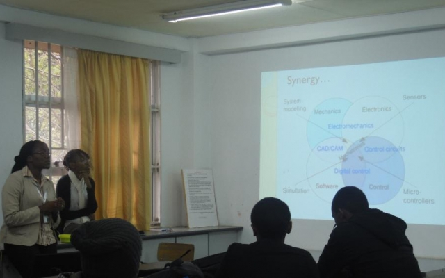 Ms. Rehema Ndeda (left), Chair of Department of Mechatronics, gives a presentation to first year students
