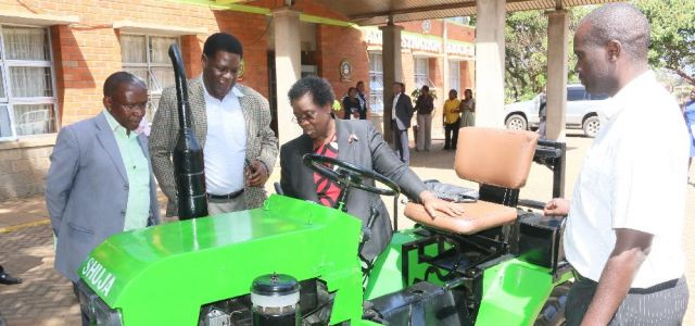 The VC, Prof. Mabel Imbuga (right), inspects a Shujaa tractor modified after a research by the departmental staff.