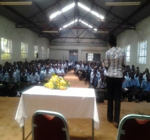 Dorothy Kanini, Gideon Kiprotich, a member of JKUGS giving study tips and life experiences while in High School to Students of Kiaria Mixed Secondary School.