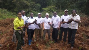 From Left Prof. Mati (in yellow), 3rd left, Eng. Gichuki of NCWSC, 4th left-Mr. Kihara of TNC, and far right, Mr. Kamau of Ahadi Kenya with others holding seedlings ready for tree planting.