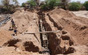 Foundation for a subsurface dam