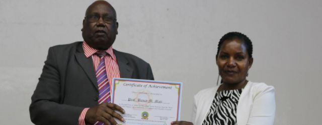 Prof. Bancy Mati  awarded certificate of recognition on best community impact by Prof. Maloiy ( Chancellor JKUAT)