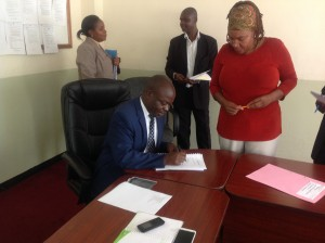 The Director Alumni and International Students Office signs her Performance Contract with the DVC(AA)