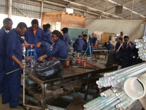 Students practicing the skills of pipe thread cutting