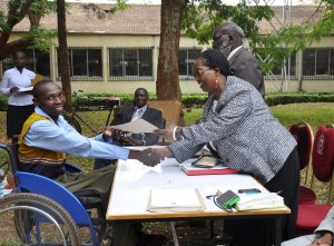 Well done! Paul Kinyanjui, one of the trainees,  is awarded a certificate by Prof. Ngumi