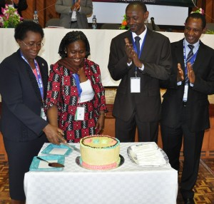 Dr. Peggy Oti-Boateng and Prof. Mabel imbuga jointly cut the cake to commemorate the launch of Journal of Sustainable Research in Engineering