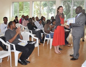 Prof. Odhiambo presents a certificate to Katharina, a Physics student from Canada, during the graduation