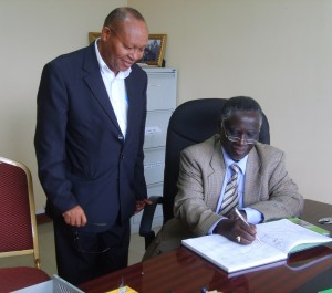 Rev. Nzimbi (Right) is receieved in Arusha Centre by Prof. Mavura