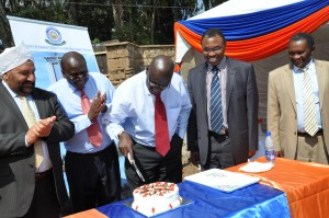 Dr. Aukot cuts the cake to mark the launch of the commercial project