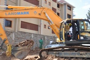 Dr. Aukot puts his earth-moving-machine driving skills to test during the breaking of the ground for the project construction.[1]