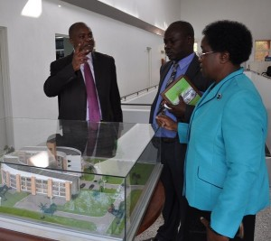 Mshindi looks at the futuristic architectural design model of JKUAT.