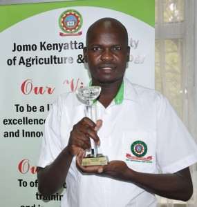 Calvince Okello posses with the trophy he won during the Transform Kenya Awards