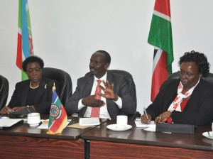 KNUT Secretary General, Wilson Sossion makes a comment during the stakeholders forum. He is  accompanied by Prof. Imbuga (left) and Mary Rotich (right),