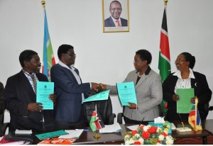 Prof Imbuga exchanging the signed CBA documents with Mr. Mberia as Prof. Ngumi looks on. Far left is Mr. Muchina