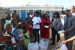 Ms. Menja (right) receiving the donations made by JKUAT from Prof. Ngumi.