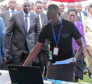 Robert Ouko,  an Information Technology student explains to Deputy President how electronic signing technology he developed works
