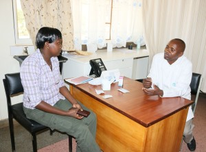 Dr. Kanyi of SOS Chilndren's Villages (right) with one of the clients