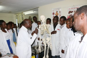 Dr. Mwaniki explains to the  first year nursing students during Human Anatomy practical session