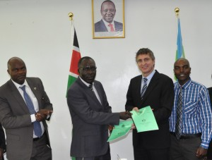 Prof. Moirongo (second left) exchange agreement documents with Prof. Schmidt as Prof. Mulati and Mukabi witnesses