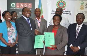 Prof. Imbuga and Mr. Musila exchange agreement documents to jointly host the July Expo