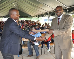 Prof. Mulati (right) presents a certificate to Mr. Gichuhi during the ceremony