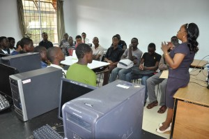 Ms. Mariam Ndungu takes a section of students through the digital section of the Library
