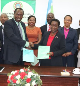 Eng. Malaquen (left) and Prof. Imbuga exchange partnership documents after renewing the MoU