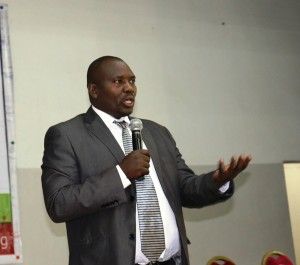 Department of Gender, Director, Dr. Johnson Kinyua, addressing participants during the Gender and Disability Mainstreaming week, opening ceremony.