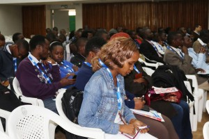 Participants follow  conference proceedings