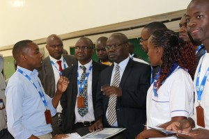 Tullow Oil representative (left) interacts with Prof. Mulati, Prof. Okong'o and Prof. Odhiambo