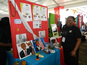 A student displays some of the products made from wastes under W2W project