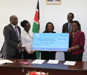 Kuria and Elizabeth presents the cheque to Prof Imbuga, Prof Ngumi and Prof Ikua