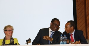 Dr. Kidero (Center) and Githinji (Right) confer on a point. Looking on is Prof. Moore