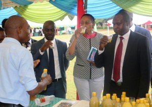 From right; Eng. Ngore, Prof. Kahangi and Tech Expo Committee Chair, Calvin Kebati have a taste of the mirra juice being exhibited at the expo