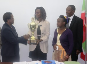 Diana present the trophy to Prof. Imbuga.