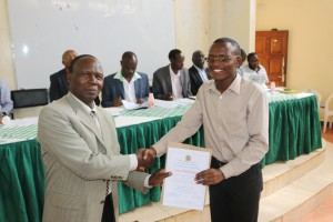 Samson Chege, Mathematics and Computer Science student recieves his certificate from Dr. David Mburu, Dean, Faculty of Agriculture