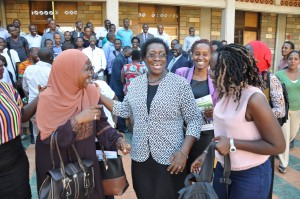 Prof. Mabel Imbuga interacts with students at the end of the induction ceremony